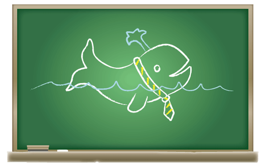 Chalk drawing of cartoon whale on blackboard